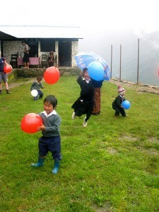 Children playing with balloons in Nepal