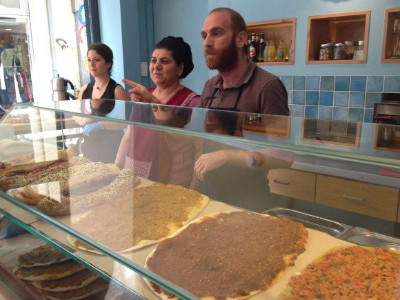 Andreas and mother Feyrouz explain the different flavours of Lahmajoun Photo: Heatheronhertravels.com