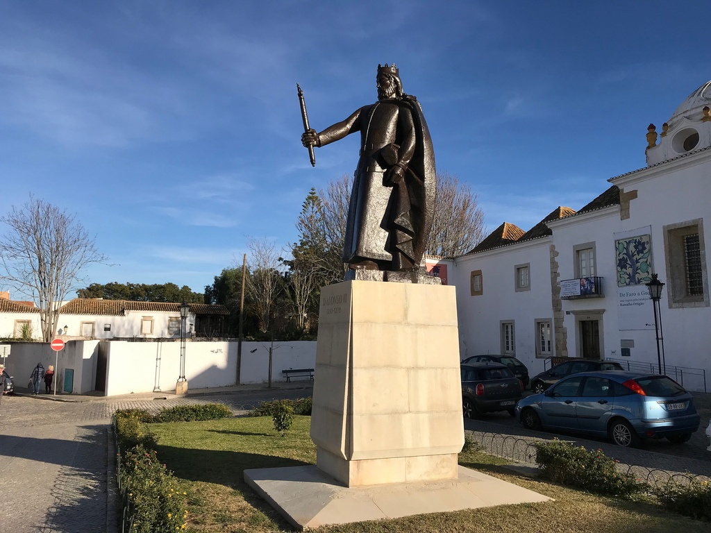 Faro things to see - King Alfonso statue Old Town Faro