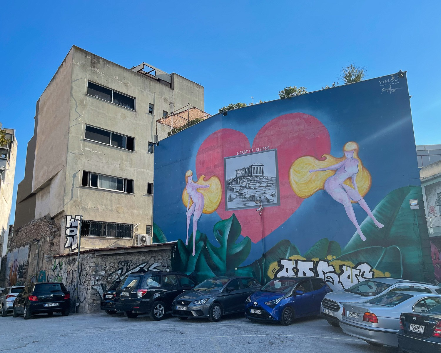 Mural in Psiri Athens - Heart of Athens by Yiakou and Simple G Photo Heatheronhertravels.com