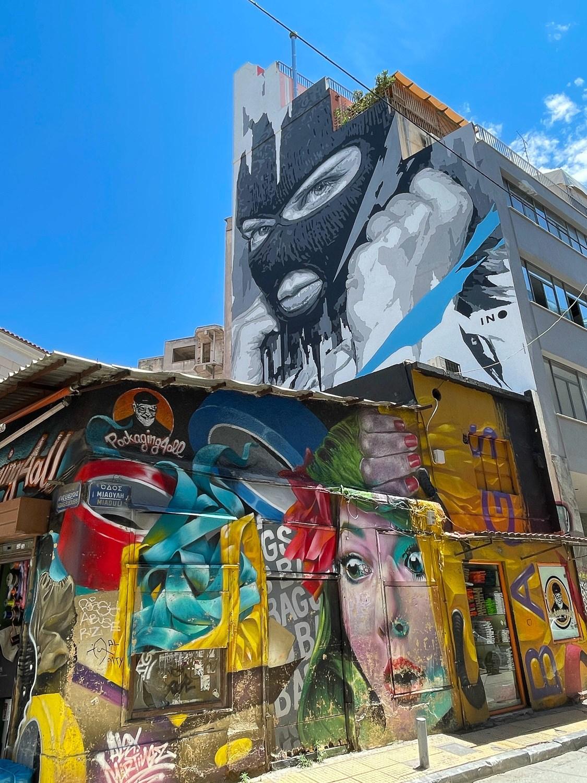 Murals in Psiri by INO and Martinez on Miaouli Athens Photo Heatheronhertravels.com